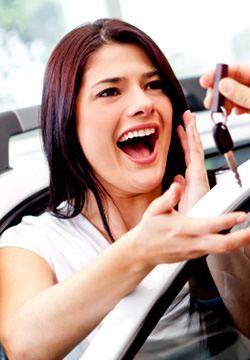 Woman receiving keys to new car