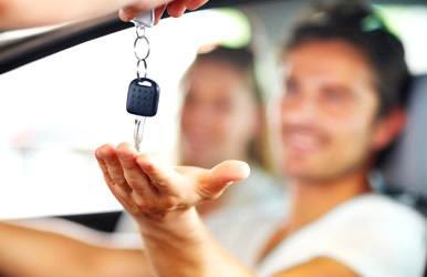 Man receiving keys to new car